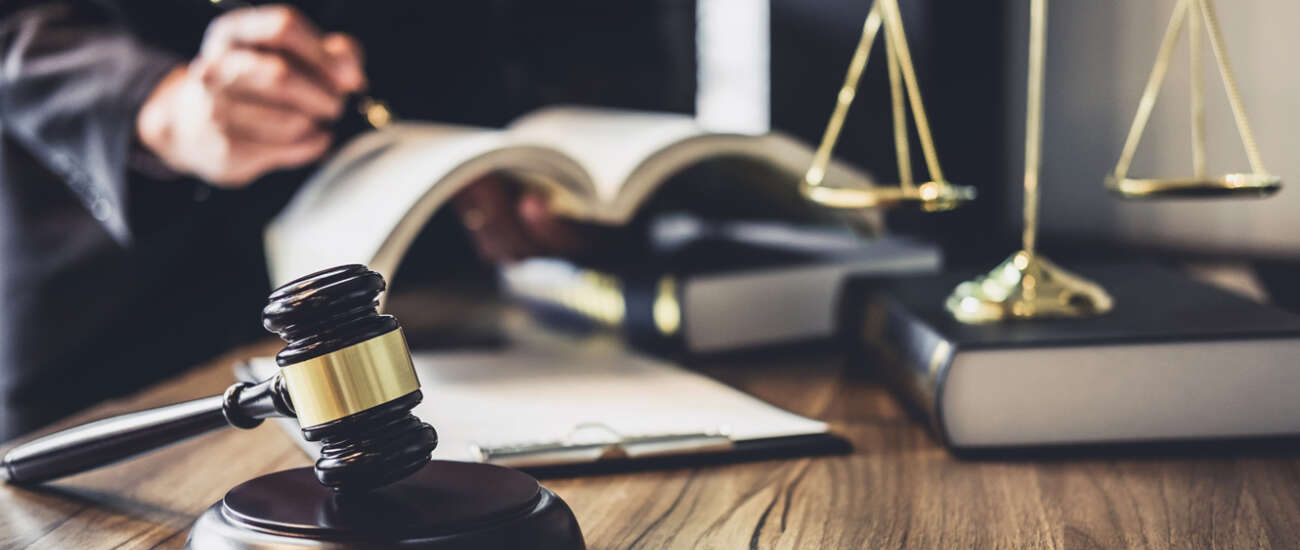 Lawyer judge counselor working with agreement contract courtroom