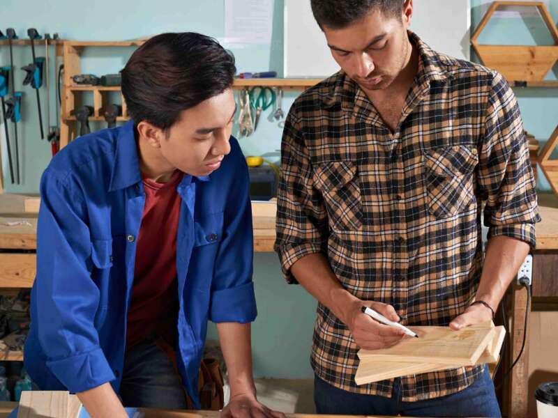 Professional worker explaining basics his newcomer colleague